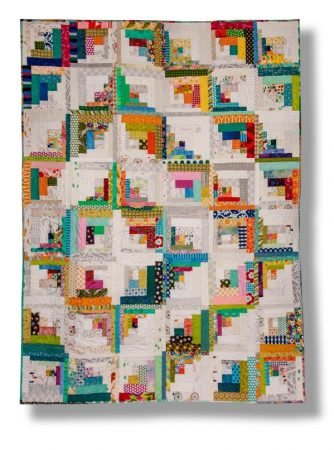 Curved log cabin quilt by Candy Grisham